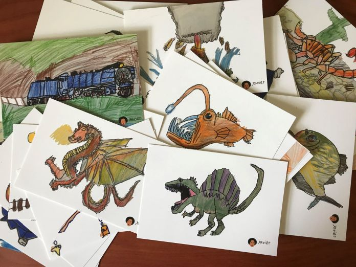 Postcards scattered with dragons, anglerfish, dinosaurs and trains